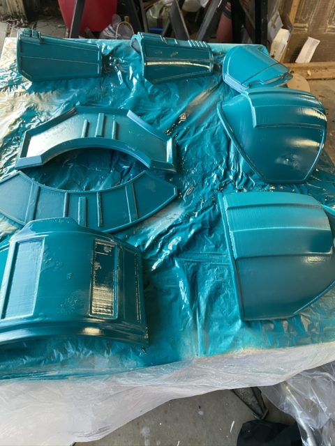 Armor with latex after being painted teal
