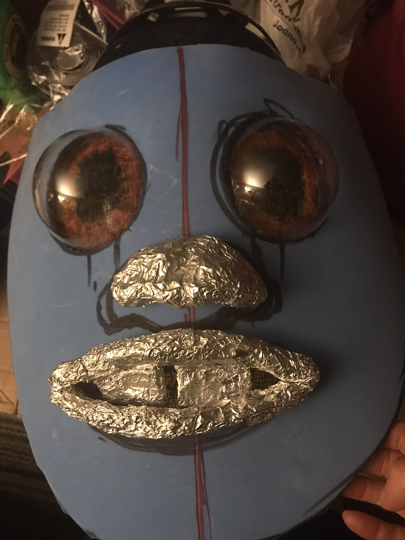 Ewok face mask with foil structure for nose and mouth